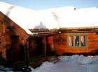 Klassisk norsk laftehytte ved Baltaz