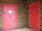 Laftehytte red coloured doors with blacksmith applications