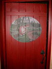 Traditional laftehytte door with painting and blacksmith application