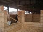 Montering av laftehytte i litauisk anlegg
