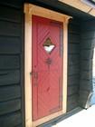Exterior laftehytte door decorated with blacksmith elements