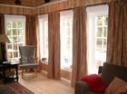 Living room of the Vestlia laftehytte designed in soft colours