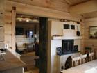 Kitchen interior of Bitihorn laftehytte designed in soft colours