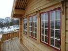 Bitihorn laftehytte windows designed in traditional norwegian style